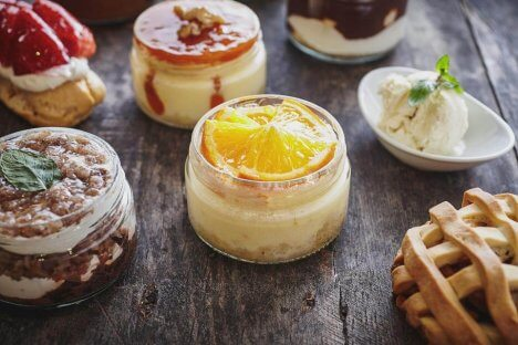 Assortment of puddings in glass jars